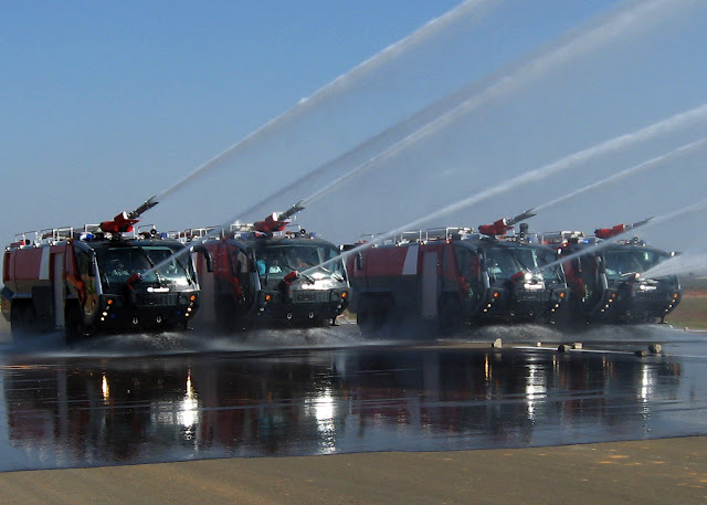 Rosenbauer Panthers of Bangalore International Airport ARFF. The floor spray extinguishes ground fires ahead of the tender.