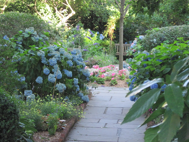 The Gardens at Saint Luke in the Fields are a must see for fans of Old New York, especially this flower path
