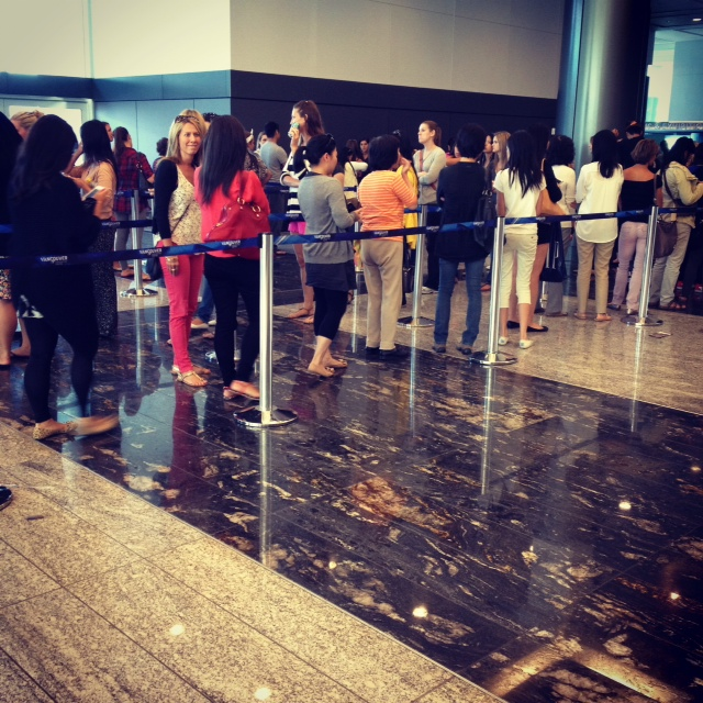 Line up for Aritzia warehouse sale inside Canada Place Convention centre