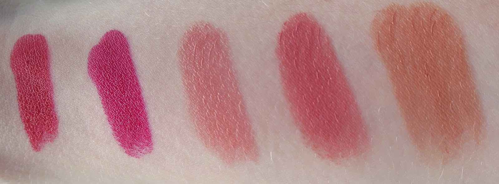 a picture of Rimmel Moisture Renew Lipsticks (arm swatch) ; Red Alert, As You Want Victoria, Let's Get Naked, Nude Delight, Coral Britannia