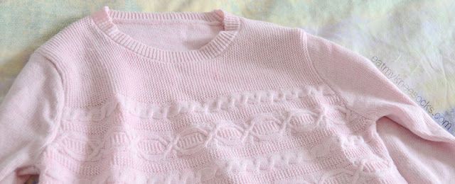 The pink pastel cable-knit sweater from SheIn, featuring long sleeves and a cute design.