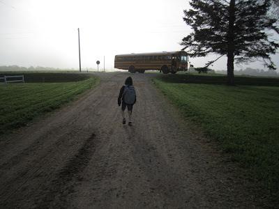 boy walking to bus