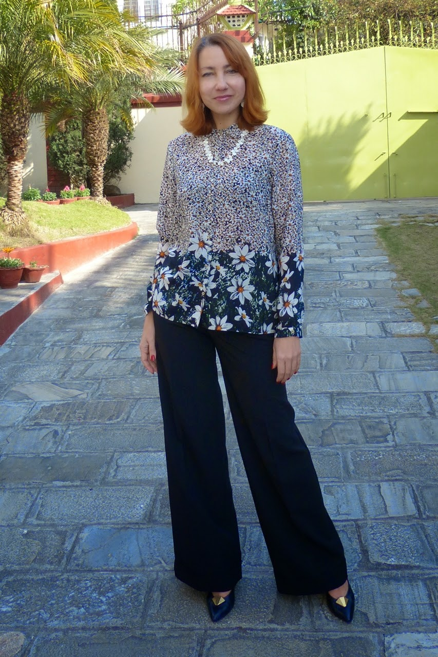 Chamomile print blouse worn with wide leg trousers