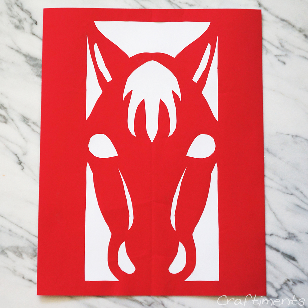 Year of the Horse paper cutting glued to cardstock
