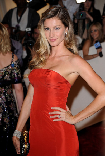 Gisele Bundchen in a red fish-tail Alexander McQueen gown at the 2011 Met Gala.