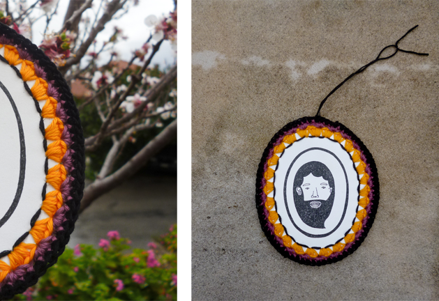 Man's character drawing with crocheted yellow, purple and black oval handmade frame
