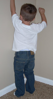 My son climbing the wall in his Denizen blue jeans