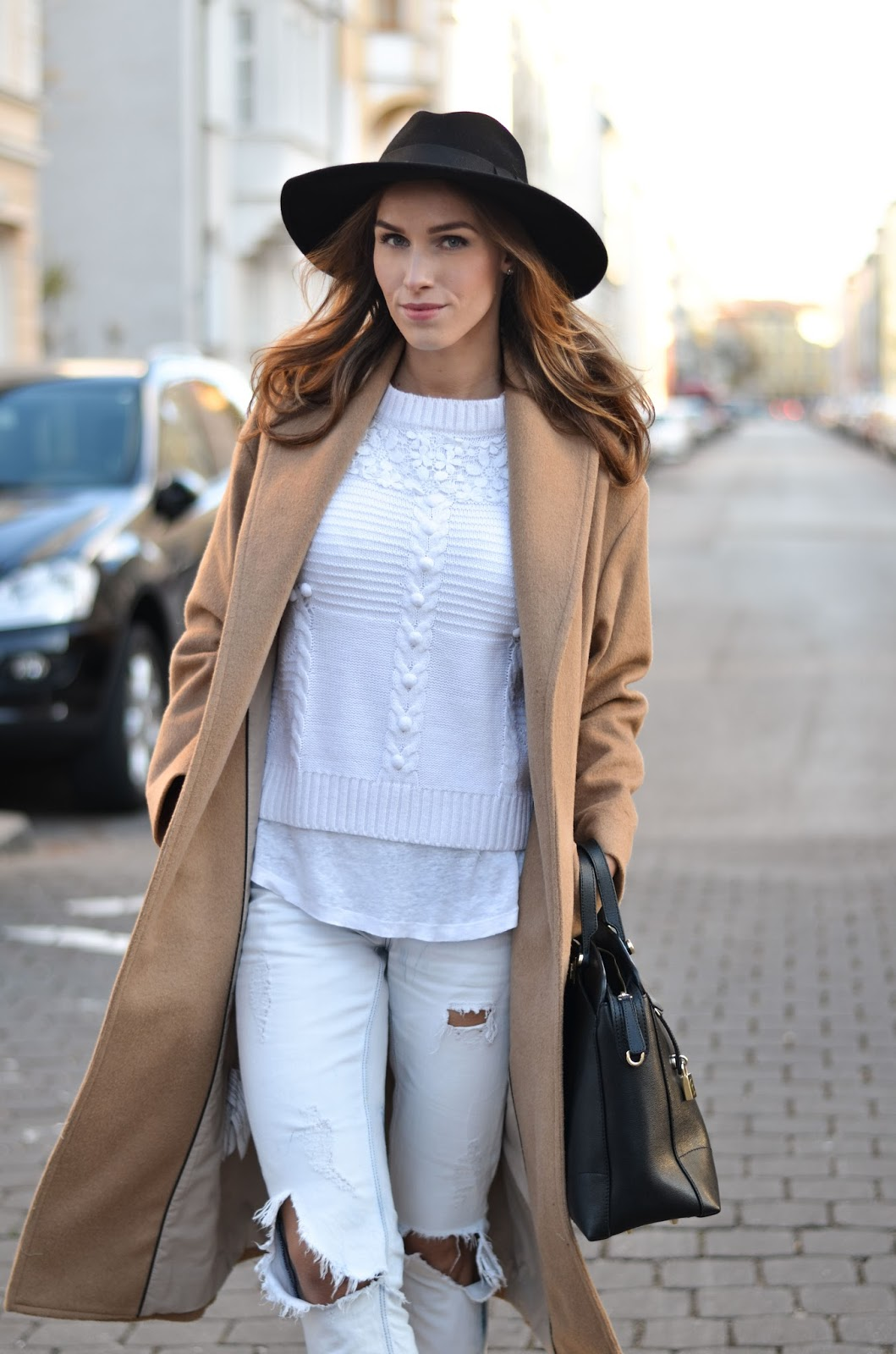 kristjaana mere camel coat black fedora white sweater ripped jeans casual winter outfit