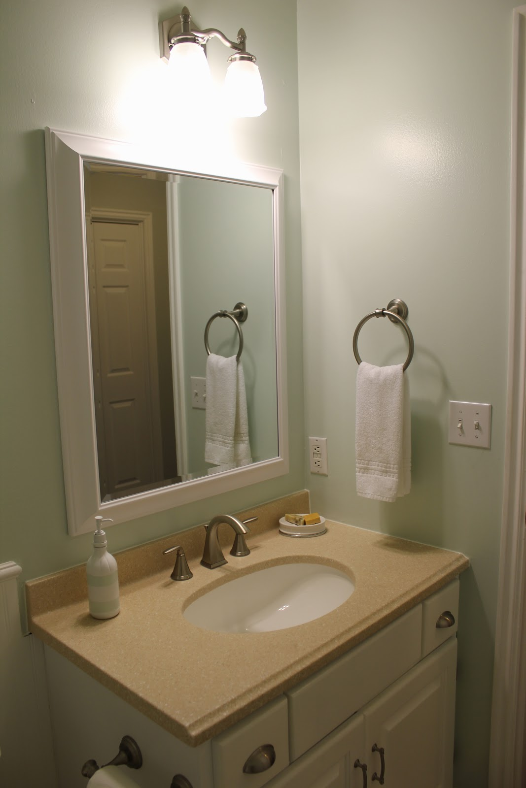 Everywhere beautiful 1 2 bath makeover for Fancy bathroom mirrors