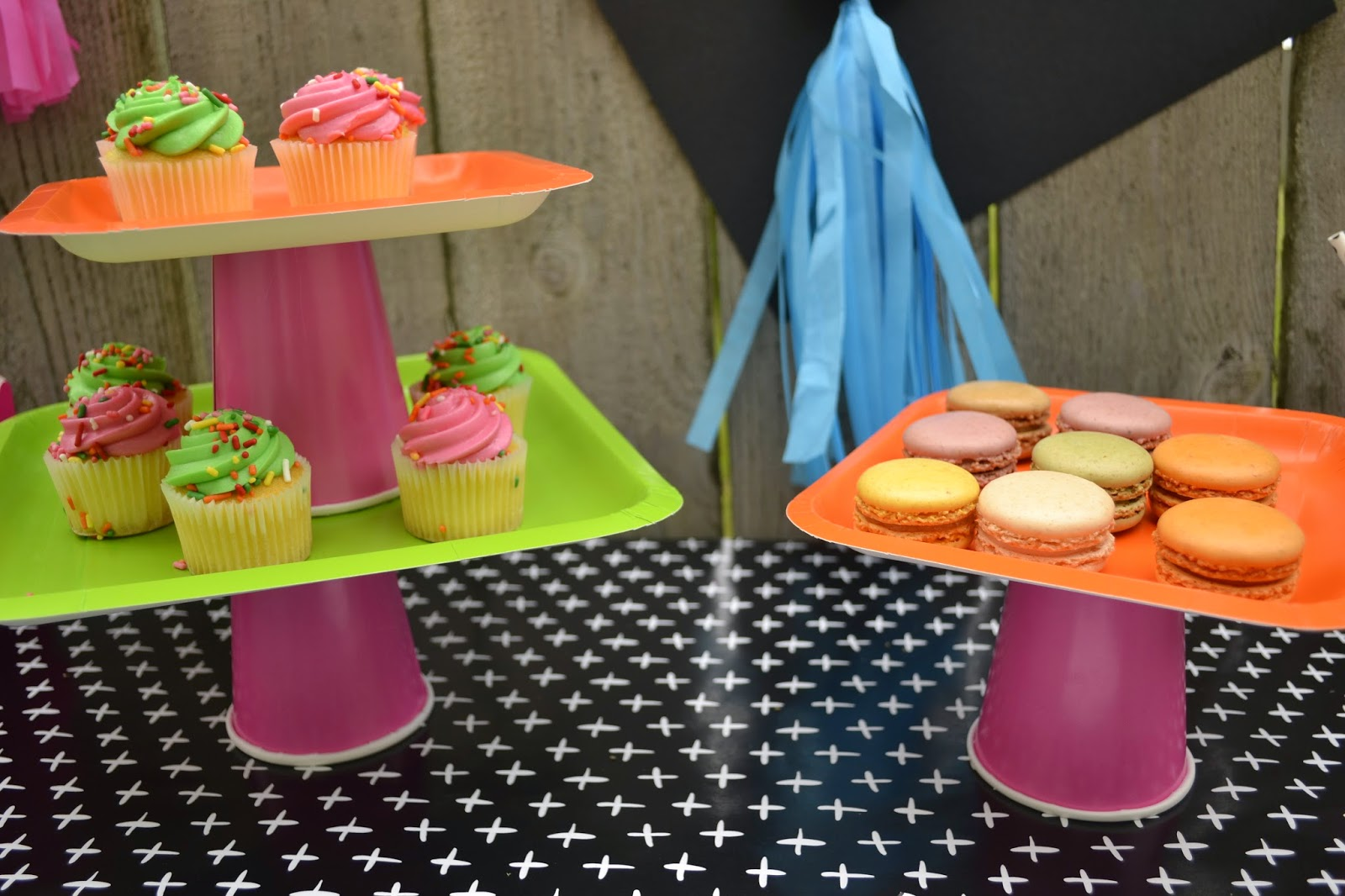 Headed For A Bright Future neon graduation party treat table cup and plate cake stand