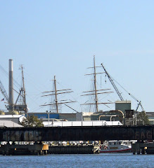 The Coast Guard's tall ship EAGLE appears to be docked behind the bridge. Can't hide her masts.
