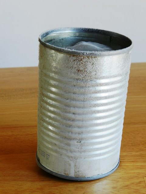 freeze water in tin can