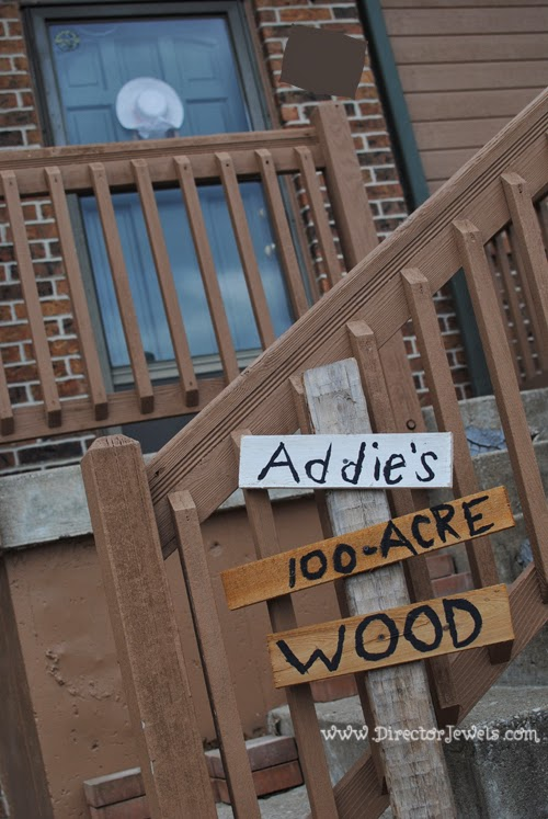 100-Acre Wood Wooden Sign. Front Door Ideas. Disney Winnie the Pooh Birthday Tea Party Decorations and Theme for Toddlers. 2nd Birthday Party Ideas. Come to tea with Piglet, Eeyore, Rabbit, Owl, Christopher Robin.