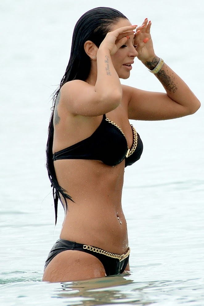 Tulisa Contostavlos in a black and gold bikini in Barbados