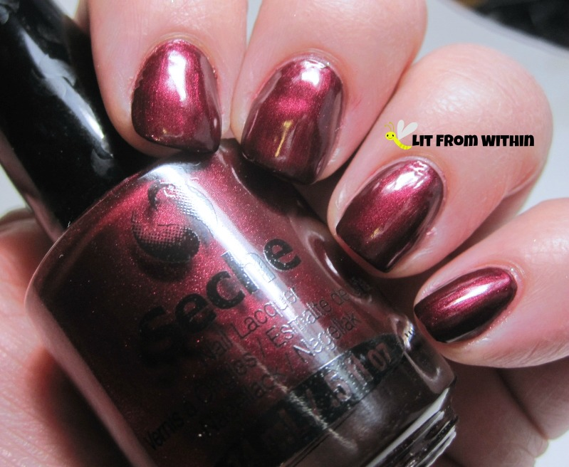 Seche Bella is a beautiful blackened red with that special glow