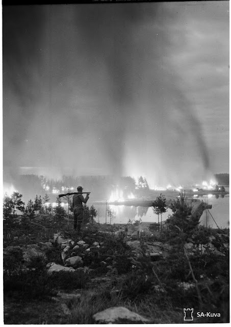 A Finnish soldier looks at the burning of the Rovaniemi town, on October 14, 1944.