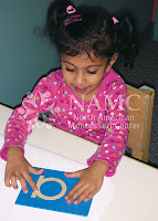 young girl works with montessori sandpaper letters the history of montessori