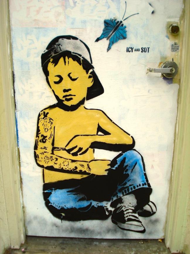 Jigsaw magazine street signs tattoo kid for Street sign tattoos