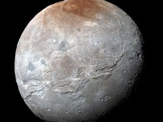 The newly photographed moon of Pluto, Charon (NASA).