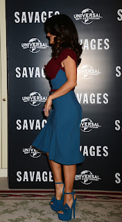 Salma Hayek shows off her body figure in a tight dress