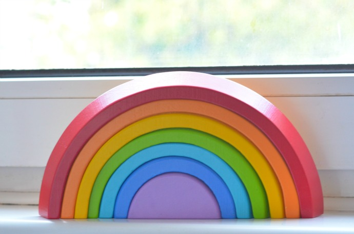 wooden rainbow, clouds and rainbow themed nursery
