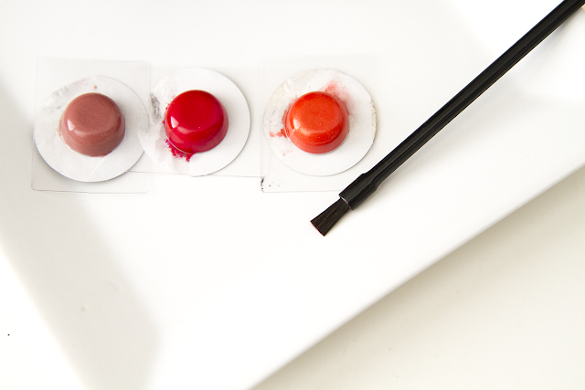 Photo of Red Apple Lipstick samples in Naughty, Hollypeno, and Sunkissed.