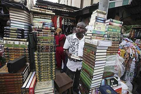 A man sells copies of the Quran,