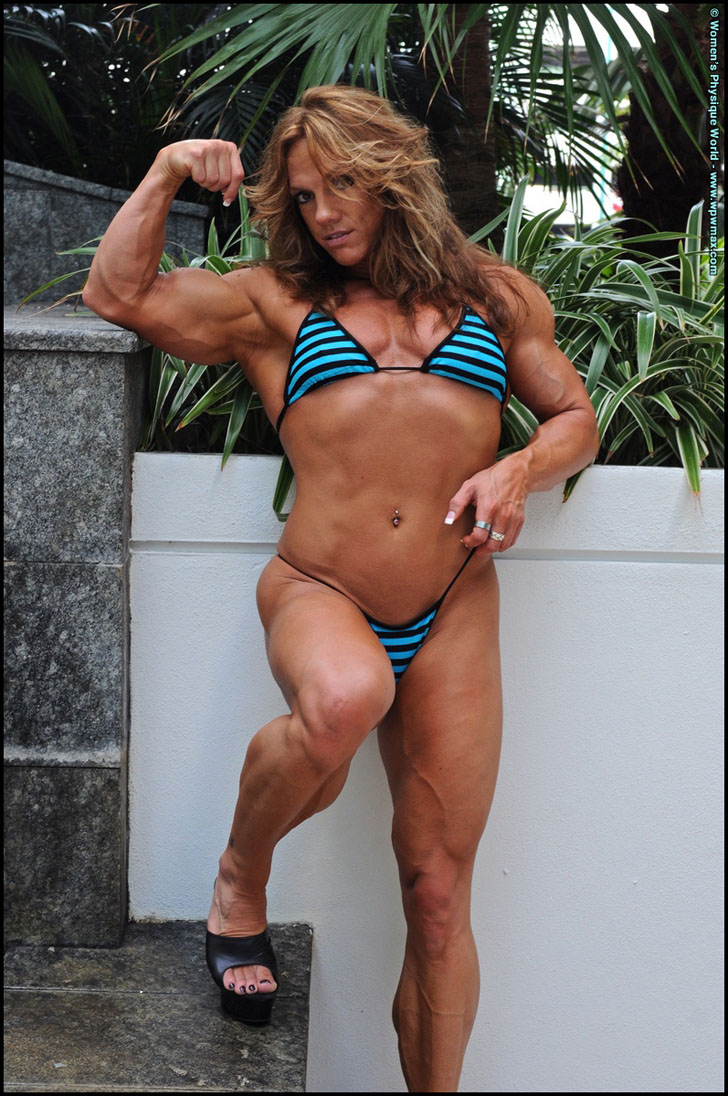 Sheila Bleck Flexing A Bicep And Modeling Her Muscular Body In A Bikini