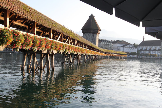 Kapellbrucke (Chapel Bridge) is one of the European's oldest wooden bridges and the landmark of Lucerne in Lucerne, Switzerland