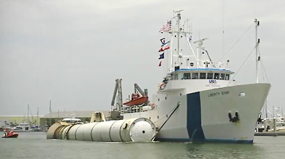 Atlantis – STS135 – Solid Fuel Rocket Booster recovered arriving to harbour. NASA-TV 2011.