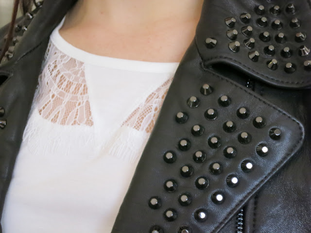 Leather jacket with studs and cream lace