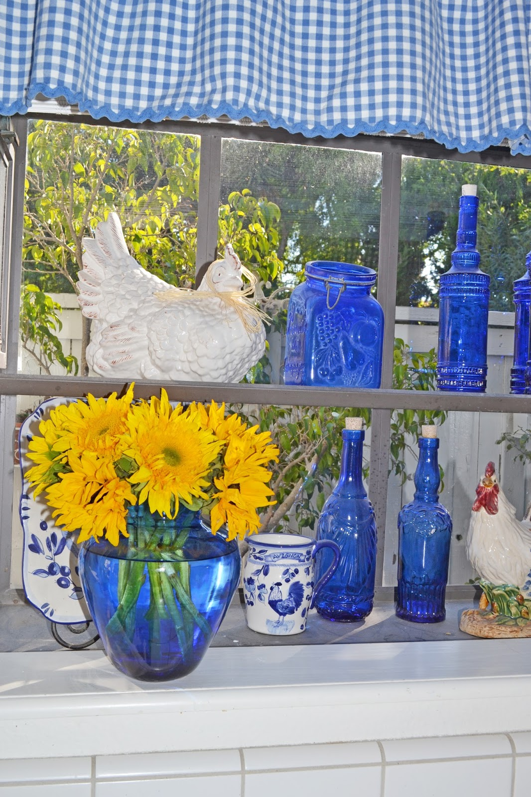 My painted garden painting roosters to match my blue and Blue and yellow room decor