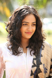 Actress Nithya Menon Picture Gallery in White Salwar Kameez at Malli Malli Idi Rani Roju Success Meet  21