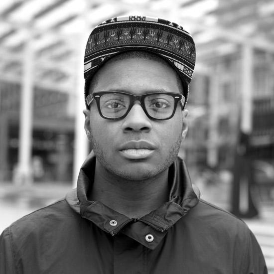 black man wearing glasses african baseball cap spring jacket