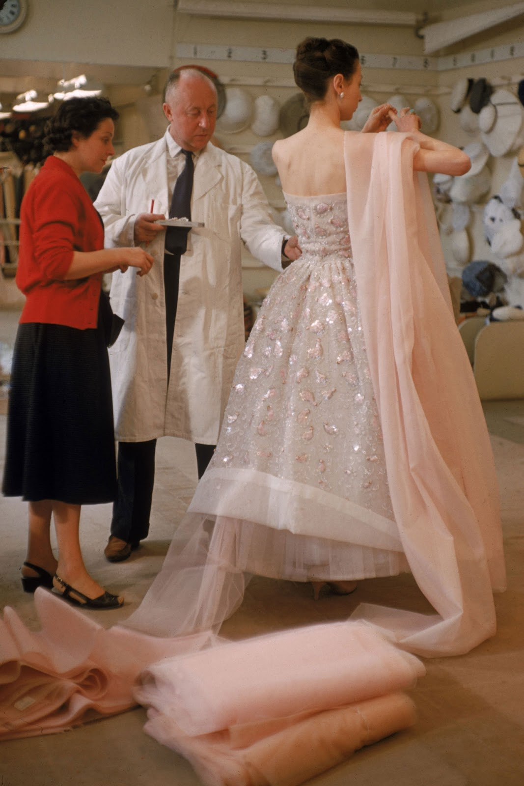 Christian Dior is working on a beaded couture gown for the Libre Haute Couture 1957 collection