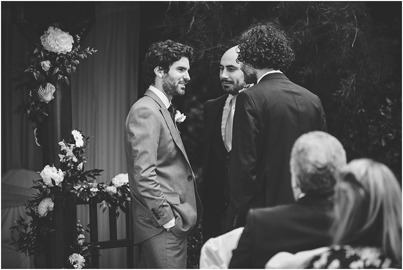 Groom talking to best men