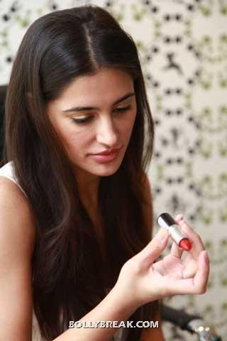Nargis Fakhri looking at lipstick  - (2) -  Nargis Fakhri at Vogue Beauty Event