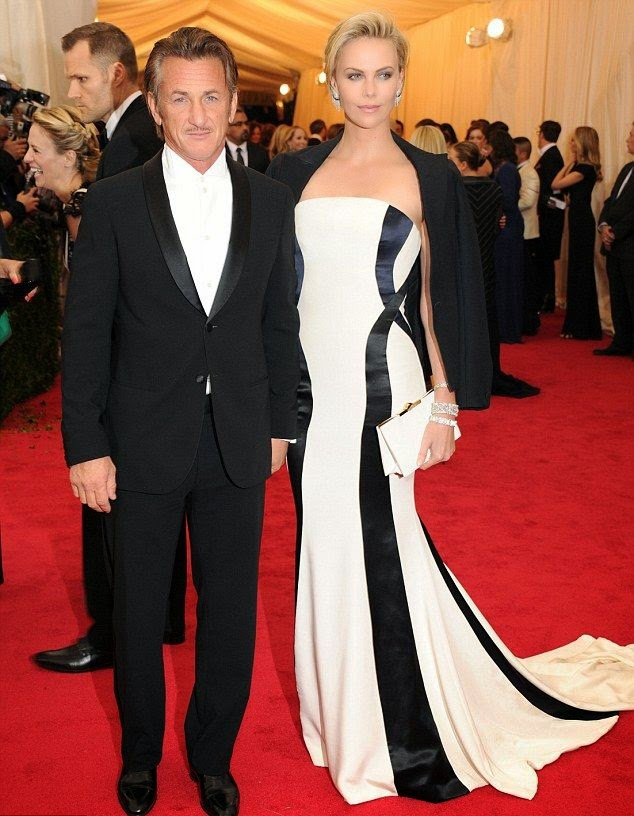 She's definitely look gorgeous and very exclusive in this long classic white dress as Charlize Theron managed the Dior gown with ease on Monday night, April 5, 2014 in New York City.