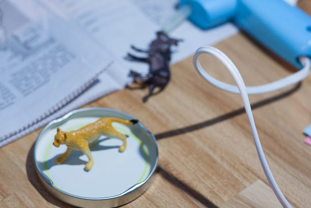 animal glued to jar lid for snow globe