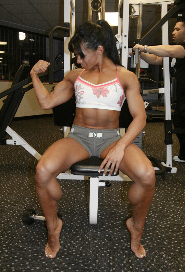 Venus Nguyen Flexes A Bicep And Her Muscular Calves
