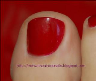 closeup of male painted toenail