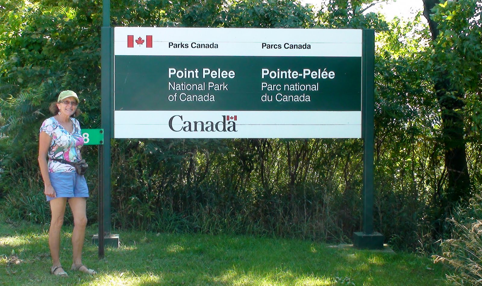 Liz by the park entrance to Point Peele National Park of Canada.