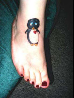 Sad-penguin-tattoo-on+foot