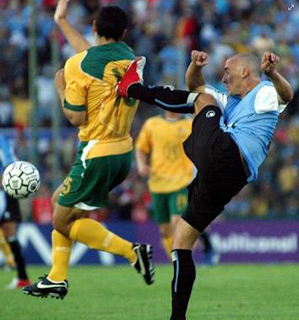 Funny photo, soccer player strikes an opponent from behind