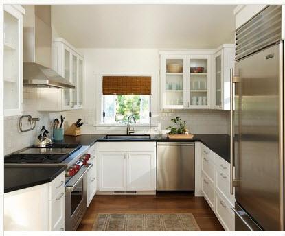 cocina en forma de u podemos ver que el lavadero esta debajo de la pequea ventana los colores de las paredes y reposteros son blancos