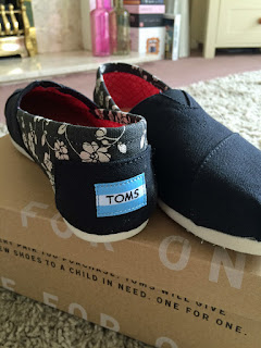 Black flowery Toms shoes