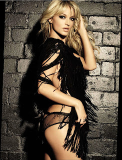 Melinda Bam posing against the brick wall in lingerie
