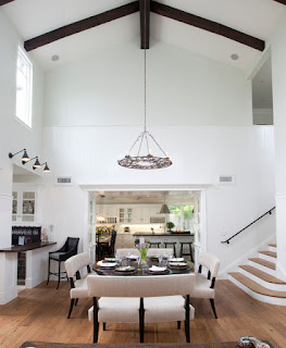 Sensational Iron Chandelier on Wooden Beams above the Dining Sets With Benches on the Hardwood Floor