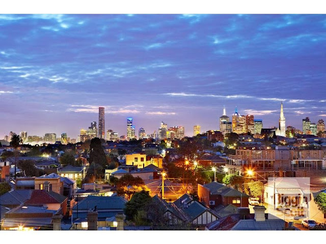 Photo of Melbourne skyline view at sunset as seen from the terrace of modern home