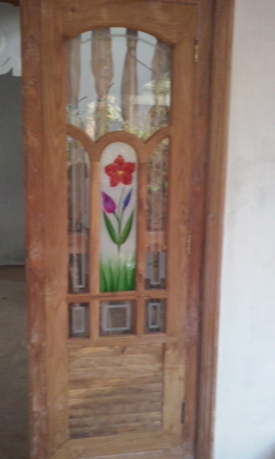 Kerala style carpenter works and designs february 2015 for Kerala style kitchen glass door